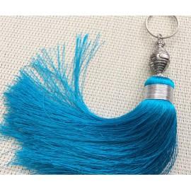 Grand pompon en soie turquoise