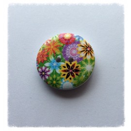 Bouton rond peint de motifs floraux