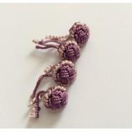 Perles bicolores en soie tons violets