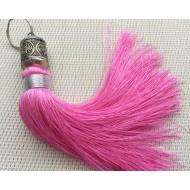 Grand pompon rose et perle en métal ciselée